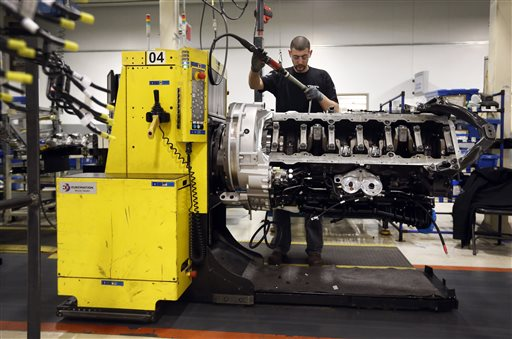 In this March 26, 2014 picture, Jon Wyand works on a truck engine assembly line at Volvo Trucks' powertrain manufacturing facility in Hagerstown, Md. The Commerce Department releases first-quarter gross domestic product on Wednesday, April 30, 2014. (AP Photo/Patrick Semansky)