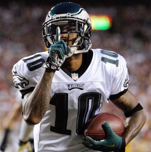 In this Sept. 9, 2013 file photo, Philadelphia Eagles wide receiver DeSean Jackson celebrates his touchdown during the first half of an NFL football game against the Washington Redskins in Landover, Md. The Eagles have released Jackson. The team cut Jackson on Friday, March 28, 2014. He was coming off a career-best season in Philadelphia, leading the team with 82 catches for 1,332 yards and nine touchdowns. (AP Photo/Nick Wass, File)