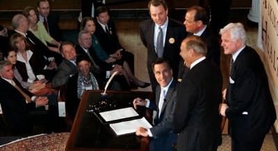 """In this April 12, 2006, file photo Massachusetts Gov. Mitt Romney, reacts at Faneuil Hall in Boston after signing into law his landmark health care bill, designed to guarantee health insurance to virtually all Massachusetts residents. The law provided a blueprint for President Barack Obama's health care law, which Romney has vowed to dismantle. Ironically the """"Romneycare"""" vs. """"Obamacare"""" debate has given Romney with his most succinct retort, that issues of health care should be left to the states, not the federal government. (AP Photo/Elise Amendola, File)"""