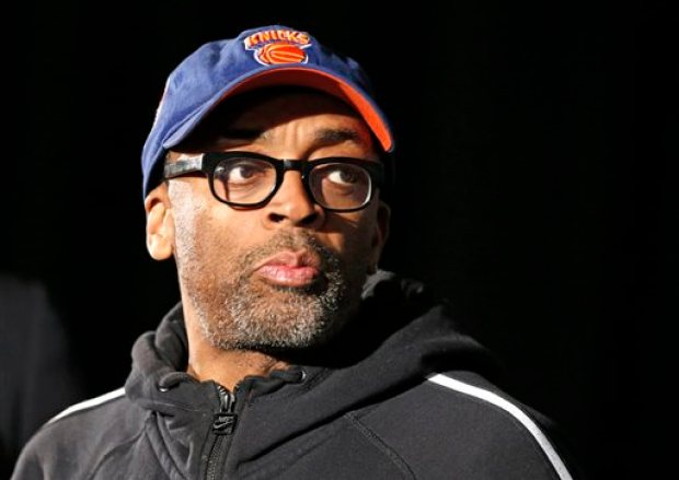 "This April 29, 2014 file photo shows filmmaker and avid basketball fan Spike Lee at a news conference by NBA Commissioner Adam Silver in New York announcing that Los Angeles Clippers owner Donald Sterling has been banned for life by the league. Lee says his wife convinced him to turn his 1986 film ""She's Gotta Have It"" into a television series for Showtime. The original story focused on a woman's relationship with three men, exploring the issues of race, sexuality and gentrification in the neighborhood of Brooklyn. Showtime will decide whether the show gets picked up or not. (AP Photo/Kathy Willens, FIle)"
