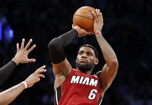 Miami Heat forward LeBron James (6) shoots a three-pointer in the second half of Game 4 of a second-round NBA playoff basketball game against the Brooklyn Nets at the Barclays Center, Monday, May 12, 2014, in New York. James tied his playoff career high with 49 points as the Heat defeated the Nets 102-96 to go ahead 3-1 in the best of seven series. (AP Photo)