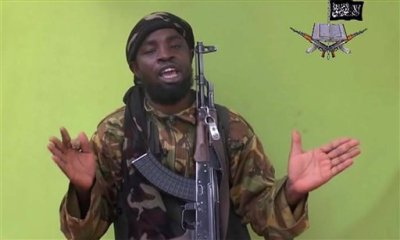 In this photo taken from video by Nigeria's Boko Haram terrorist network, Monday May 12, 2014 shows their  leader Abubakar Shekau speaking to the camera. The new video purports to show dozens of abducted schoolgirls, covered in jihab and praying in Arabic. It is the first public sight of the girls since more than 300 were kidnapped from a northeastern school the night of April 14, 2014. (AP Photo)