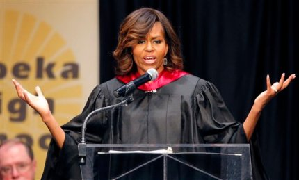 First lady Michelle Obama speaks during Topeka Public Schools Senior Recognition Program in Topeka, Kan., Friday, May 16, 2014. (AP Photo/Orlin Wagner)