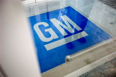 In this Thursday, Jan. 10, 2013 file photo, the logo for General Motors decorates the entrance at the site of a GM information technology center in Roswell, Ga. GM is recalling 2.6 million small cars worldwide to replace ignition switches that suddenly can slip out of the run position and shut off the engine.  (AP Photo/David Goldman, File)