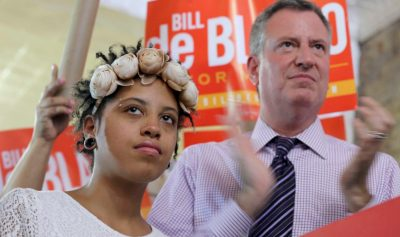 This Sept. 7, 2013 photo shows Democratic mayoral hopeful Bill de Blasio, right, and his daughter Chiara, during a campaign rally in the Brooklyn borough of New York. Chiara de Blasio has opened up about her history battling substance abuse and depression in a four minute video released by de Blasio's Transition team. Chiara admitted she drank alcohol and smoked marijuana to deal with clinical depression and anxiety but is now sober after getting treatment in a local outpatient clinic.(AP Photo/Mary Altaffer, File)