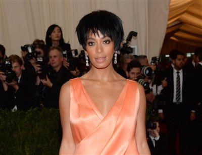 """This May 5, 2014 file photo shows Solange Knowles, sister of Beyonce Knowles, at The Metropolitan Museum of Art's Costume Institute benefit gala celebrating """"Charles James: Beyond Fashion"""" in New York. Beyonce, Jay Z and Solange say they have worked through and are moving on since a video leaked this week of Solange attacking Jay Z in an elevator inside the Standard Hotel after the May 5, gala. (Photo by Evan Agostini/Invision/AP)"""
