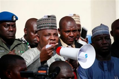 Borno state governor, Kashim Shettima, center, addresses demonstrators who were calling on the government to rescue the kidnapped schoolgirls of the Chibok secondary school, in Abuja, Nigeria, Tuesday, May 13, 2014. (AP Photo / Sunday Alamba)