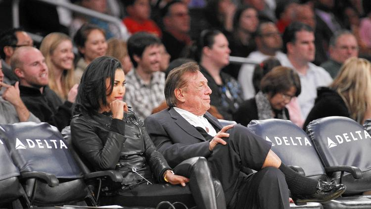 Donald Sterling and V. Stiviano attend a Clippers game in 2011. The NBA has compiled a voluminous collection of accusations and statements in its effort to strip Donald Sterling and his wife, Shelly, of ownership of the team. (Danny Moloshok/AP)