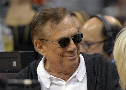 In this Nov. 7, 2012 file photo, Los Angeles Clippers owners Donald Sterling and his wife, Shelly, obscured at right, watch the Clippers play the San Antonio Spurs during the second half of an NBA basketball game in Los Angeles. Sterling's team of lawyers has hired four private investigation firms to dig up dirt on the NBA's former and current commissioners and its 29 other owners, said a person familiar with Sterling's legal strategy. Investigators were given a six-figure budget over the next 30 days to examine the league's finances, allegations of previous discriminatory conduct and compensation to past Commissioner David Stern and current Commissioner Adam Silver, said the person who spoke to The Associated Press on Thursday night , June 12, 2014, on condition of anonymity. (AP Photo/Mark J. Terrill, File)