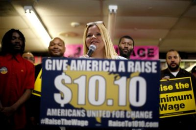 In this photo made Friday, April 25, 2014, Amy Jennewein speaks during a rally in support of raising the minimum wage University City, Mo. Jennewein, who lives in the outer St. Louis suburb of House Springs, earns a little above Missouri's $7.50 minimum wage at one of her jobs and nearly $11 an hour at the other. (AP Photo/Jeff Roberson)