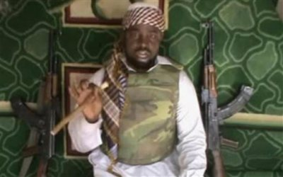 This file image made available from Wednesday, Jan. 10, 2012, taken from video posted by Boko Haram sympathizers shows Imam Abubakar Shekau, the leader of the radical Islamist sect. Boko Haram militants dressed as soldiers slaughtered at least 200 civilians in three villages in northeastern Nigeria and the military failed to intervene even though it was warned that an attack was imminent, witnesses said on Thursday, June 5, 2014. (AP Photo/File)