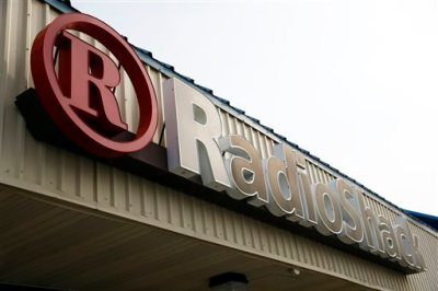 This March 25, 2014 photo shows a RadioShack store sign in Philadelphia. RadioShack on Tuesday, June 10, 2014 reported its first-quarter loss widened and revenue slumped as the retailer dealt with weakness in its mobile business and consumer electronics. (AP Photo/Matt Rourke)