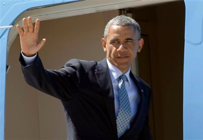 President Barack Obama waves to supporters as he boards Air Force One to return to Washington at Los Angeles International Airport Thursday, July 24, 2014 in Los Angeles. (AP Photo)