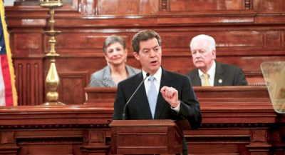 Kansas Gov. Sam Brownback talks about the need for clean water during his State of the State address on Wednesday, Jan. 15, 2014, in Topeka, Kan. (AP Photo/The Topeka Capital Journal, Chris Neal)