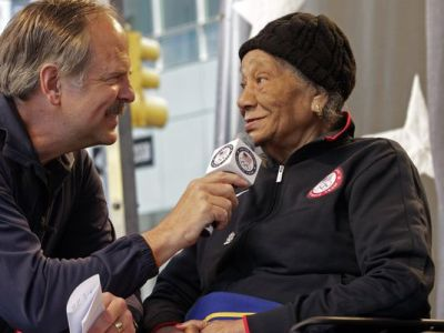This April 18, 2012, file photo shows Olympic swimming great John Nabor, left, interviewing Alice Coachman Davis, a gold medalist in the high jump at the 1948 Olympics, during U.S. Olympic team festivities in New York's Times Square. (Bebeto Matthews, AP Photo)