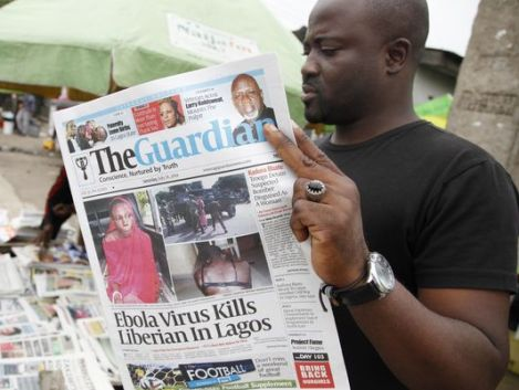 A man reads a local newspaperson a street with the headline Ebola Virus kills Liberian in Lagos, in Lagos Nigeria, Saturday, July 26, 2014. An Ebola outbreak that has left more than 600 people dead across West Africa has spread to the continent's most populous nation after a Liberian man with a high fever vomited aboard an airplane to Nigeria and then died there, officials said Friday. The 40-year-old man had recently lost his sister to Ebola in Liberia, health officials there said. It was not immediately clear how he managed to board a flight, but he was moved into an isolation ward upon arrival in Nigeria on Tuesday and died on Friday. (Sunday Alamba/AP)