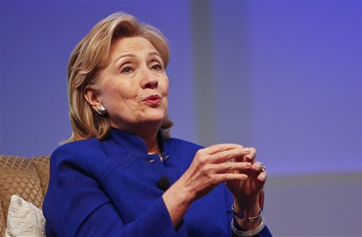 "This June 25, 2014, file photo shows former Secretary of State Hillary Rodham Clinton speaking in San Diego. There may be more to that ""we the people"" notion than you thought.These are boom times for the concept of ""corporate personhood."" Corporations are people? Mitt Romney got mocked during the 2012 presidential campaign for the very idea. But it turns out the principle has been lurking in U.S. law for more than a century, and the Supreme Court, in a 5-4 ruling, gave it more oomph this week when it ruled that certain businesses are entitled to exercise religious rights just as do people.  (AP Photo/Lenny Ignelzi, File)"