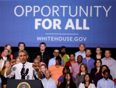President Barack Obama speaks about the economy, Wednesday, July 30, 2014, at the Uptown Theater in Kansas City, Mo. (AP Photo/Charlie Riedel)