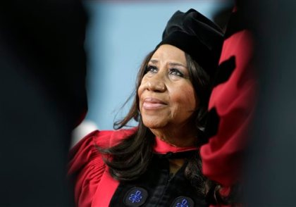 In a Thursday, May 29, 2014 file photo, singer Aretha Franklin looks up while seated on stage during Harvard University commencement ceremonies, in Cambridge, Mass. Franklin, the Queen of Soul says she's looking forward to tracking down one of the powdered sugar-covered confections while she's at the Ohio State Fair to perform on Thursday, July 31, 2014. (AP Photo/Steven Senne, File)