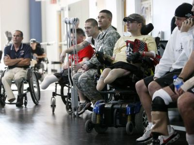 In this Nov. 8, 2007 file photo, wounded soldiers involved in physical therapy wait for President Bush to visit a physical therapy lab for wounded soldiers at the Center For The Intrepid at the Brooke Army Medical Center in San Antonio. (Gerald Herbert, AP)