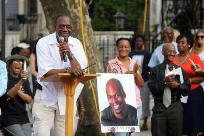 """Ardie Fuqua Sr. talks about his son, Ardie Fuqua, during a prayer vigil Monday, July 7, 2014, in Jersey City, N.J., Fuqua, a comedian, was injured in the same car crash that killed James """"Uncle Jimmy Mack"""" McNair of Peekskill and seriously hurt Tracy Morgan.  (AP Photo/The Jersey Journal, Michael Dempsey)"""