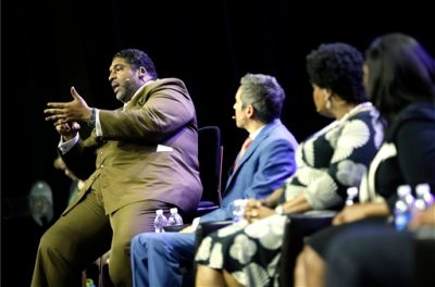 William Barber, left, speaks during a panel discussion on black turnout for midterm elections and voter suppression during the NAACP annual convention Tuesday, July 22, 2014, in Las Vegas. (AP Photo/John Locher)