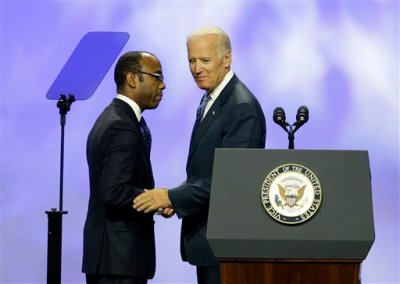 """Vice President Joe Biden, right, shakes hands with NAACP President and CEO Cornell William Brooks at the NAACP annual convention Wednesday, July 23, 2014, in Las Vegas. Biden called on members of the NAACP to spread the word about what he called """"a hailstorm"""" of measures to restrict citizens' ability to vote, trying to rally the Democratic Party''s base before the midterm elections. (AP Photo/John Locher)"""