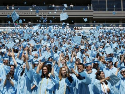 University of North Carolina-Chapel Hill graduates toss their mortar boards into the air during commencement exercises on May 9, 2010. (Photo: Takaaki Iwabu, AP)