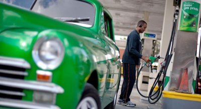 A man at a gas station is shown. (AP Photo)