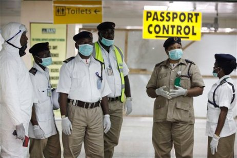 Nigeria health officials wait to screen passengers at the arrival hall of Murtala Muhammed International Airport in Lagos, Nigeria, Monday, Aug. 4, 2014. Nigerian authorities on Monday confirmed a second case of Ebola in Africa's most populous country, an alarming setback as officials across the region battle to stop the spread of a disease that has killed more than 700 people. (AP Photo/Sunday Alamba)