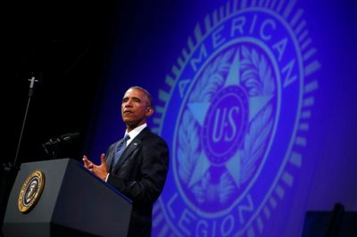 President Barack Obama speaks about veterans issues at the American Legion's 96th National Convention at the Charlotte Convention Center in Charlotte, N.C., Tuesday, Aug. 26, 2014. Three months after a veterans' health care scandal rocked his administration, President Barack Obama is taking executive action to improve the mental well-being of veterans. The president was to announce his initiatives during an appearance before the American Legion National Convention that is fraught with midterm politics. (AP Photo/Charles Dharapak)