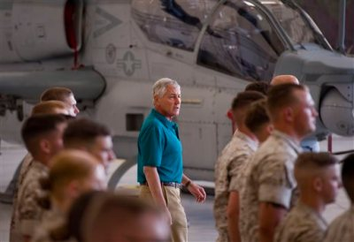 WIth Marines standing at attention, Secretary of Defense Chuck Hagel arrives at a Camp Pendleton hangar where addressed the Marines and answered questions Tuesday Aug. 12, 2014. Hagel announced the deployment of another 130 U.S. troops to Iraq in remarks to Marines at this Southern California base on the final stop of a weeklong, around-the-world trip that also took him to India, Germany and Australia. (AP Photo/The Orange County Register, Paul Rodriguez)