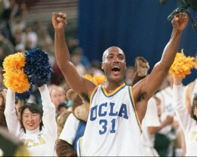 In this April 3, 1995 photo, UCLA's Ed O'Bannon celebrates after his team won the  championship NCAA game against Arkansas in Seattle. A federal judge has ruled that the NCAA can't stop college football and basketball players from selling the rights to their names and likenesses, opening the way to athletes getting payouts once their college careers are over, Friday, Aug. 8, 2014. (AP Photo/Eric Draper, File)