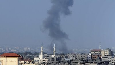 Smoke over Gaza where Israeli forces staged raids shortly before the truce began, while militants fired rockets into Israel ahead of the ceasefire. (AP Photo)