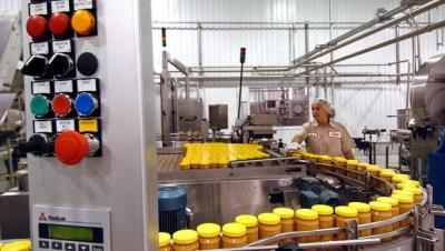 An Aug. 10, 2005 file photo shows the peanut butter production line at Sunland Inc's peanut plant in Portales, N.M. (AP Photo/Albuquerque Journal, Richard Pipes)