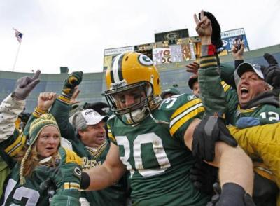 Green Bay Packers fullback John Kuhn celebrates a touchdown with a Lambeau Leap into the hometown. (Matt Ludtke/AP)