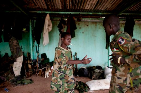 In this Friday, May 11, 2012 file photo, a young South Sudanese soldier who appeared to be drunk reaches for a lighter for his cigarette at the Sudan People's Liberation Army (SPLA) headquarters in Bentiu, Unity State, South Sudan. The U.N.'s top official for children and armed conflicts Leila Zerrougui said during a stop in Kenya on Thursday, Aug. 21, 2014 that the use of child soldiers and violence against children is commonplace in South Sudan's year of warfare. (AP Photo/Pete Muller, File)