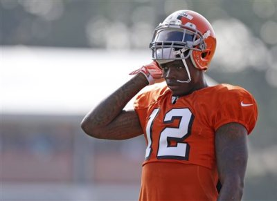 In this Aug. 4, 2014, file photo, Cleveland Browns wide receiver Josh Gordon rests during practice at the NFL football team's training campin Berea, Ohio. Gordon has been suspended by the NFL one year for violating the league's substance abuse policy. Gordon's suspension is effective immediately and he will miss the entire 2014 season.  (AP Photo/Tony Dejak, File)