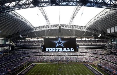 In this Nov. 3, 2013, file photo, the roof is open on the stadium before an NFL football game between the Dallas Cowboys and the Minnesota Vikings in Arlington, Texas. Forbes says Cowboys are the first U.S. sports franchise to top $3 billion in value. For the eighth straight year, the Cowboys are worth the most of all 32 NFL franchises, valued at $3.2 billion. (AP Photo/Sharon Ellman, File)