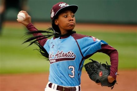 Pennsylvania's Mo'ne Davis delivers in the fifth inning against Tennessee during a baseball game in United States pool play at the Little League World Series tournament in South Williamsport, Pa., Friday, Aug. 15, 2014. Pennsylvania won 4-0 with Davis pitching a complete game two-hit shutout. (AP Photo/Gene J. Puskar)