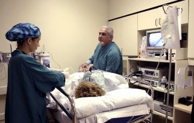 A doctor prepares to do a colonoscopy in Miami. (Lynne Sladky/AP)