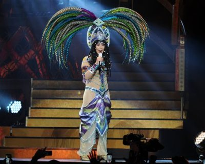 In this May 17, 2014 file photo, Cher performs during the D2K Tour 2014 at the BB&T Center in Sunrise, Fla. Three backup dancers have sued Cher claiming they were wrongfully fired from her current tour and the singer engaged in racial discrimination. The trio filed a wrongful termination lawsuit in Los Angeles Superior Court on Thursday, Sept. 18, 2014.   (Photo by Jeff Daly/Invision/AP, file)