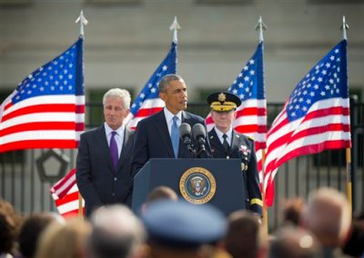 President Barack Obama, flanked by Defense Secretary Chuck Hagel, and Joint Chefs Chairman Gen. Martin Dempsey, speaks at the Pentagon, Thursday, Sept. 11, 2014, to mark the 13th anniversary of the 9/11 attacks. (AP Photo/Pablo Martinez Monsivais)