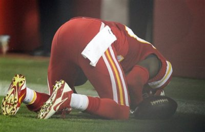 In this Sept. 29, 2014, photo, Kansas City Chiefs free safety Husain Abdullah prays after intercepting a pass and running it back for a touchdown during the fourth quarter of an NFL football game against the New England Patriots Monday, Sept. 29, 2014, in Kansas City, Mo. The NFL said Tuesday, Sept. 30,  that Abdullah should not have been penalized for unsportsmanlike conduct when he dropped to his knees in prayer after the interception. (AP Photo/Ed Zurga)