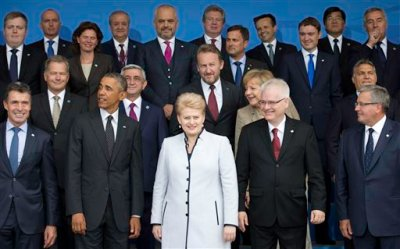From front left, NATO Secretary General Anders Fogh Rasmussen, U.S. President Barack Obama, Lithuanian President Dalia Grybauskaite and Croatian President Ivo Josipovic pose for a group photo during a NATO summit at the Celtic Manor Resort in Newport, Wales on Thursday, Sept. 4, 2014. In a two-day meeting leaders will discuss, among other issues, the situation in Ukraine and Afghanistan. (AP Photo/Jon Super)