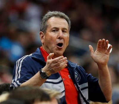 """In this April 26, 2014, file photo, Atlanta Hawks co-owner Bruce Levenson cheers from the stands in the second half of Game 4 of an NBA basketball first-round playoff series against the Indiana Pacers in Atlanta. Levenson said Sunday, Sept. 7, 2014, he is selling his controlling interest in the team, in part due to an inflammatory email he said he wrote in an attempt """"to bridge Atlanta's racial sports divide."""" (AP Photo/John Bazemore, File)"""