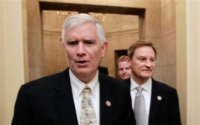 "This July 28, 2011 file photo shows Rep. Mo Brooks, R-Ala., left, on Capitol Hill in Washington. The tea party may have learned its lesson. As Congress finishes work on a must-pass spending bill set for votes next week, the most conservative lawmakers on Capitol Hill are eager to send a message on immigration, and stand firm against a government lending bank. But a year after they forced a 16-day partial government shutdown over President Barack Obama's health care law, few seem to have the stomach to push their demands that far again. ""No question we learned that with the aid of the news media the Democrats were able to pin the blame on us"" for last year's shutdown, said Brooks. (AP Photo/J. Scott Applewhite, File)"