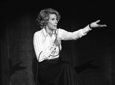 In this Aug. 13, 1975 photo released by the Las Vegas News Bureau, comedian Joan Rivers performs at the MGM in Las Vegas, Nev. Rivers, the raucous, acid-tongued comedian who crashed the male-dominated realm of late-night talk shows and turned Hollywood red carpets into danger zones for badly dressed celebrities,  died Thursday, Sept. 4, 2014. She was 81. Rivers was hospitalized Aug. 28, after going into cardiac arrest at a doctor's office. (AP Photo/Las Vegas News Bureau)