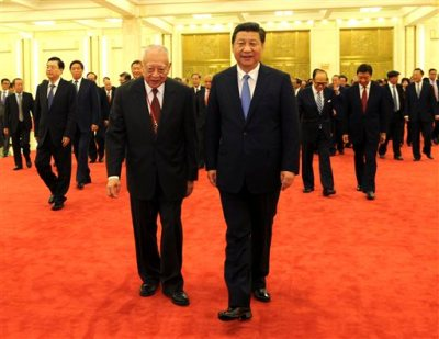 In this Sept. 22, 2014 photo provide by China's Xinhua News Agency, Chinese President Xi Jinping, front right, meets with a delegation of Hong Kong's industrial and business circles headed by Tung Chee-hwa, left front, in Beijing, capital of China. (AP Photo/Xinhua, Rao Aimin)