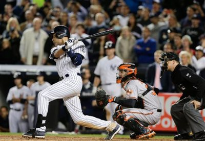 New York Yankees' Derek Jeter follows through on a base hit to right field that scored Antoan Richardson with the winning run against the Baltimore Orioles in the ninth inning of a baseball game, Thursday, Sept. 25, 2014, in New York. The Yankees won 6-5. (AP Photo/Julie Jacobson)